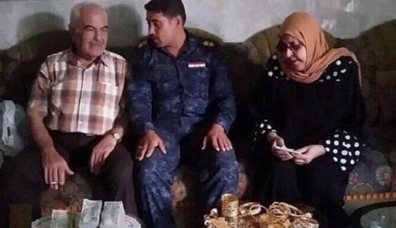 Musul'da bulduğu 100 bin dolar ve 1,5 kg altını aileye teslim etti