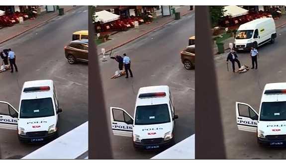 İki polis, bir kadını copla dövüp tekme attı, saçından tutup yerlerde sürükledi!