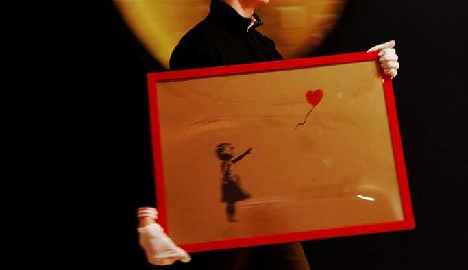 Banksy'nin eseri yaklaşık 1 milyon sterline satıldıktan sonra kendi kendini yok etti