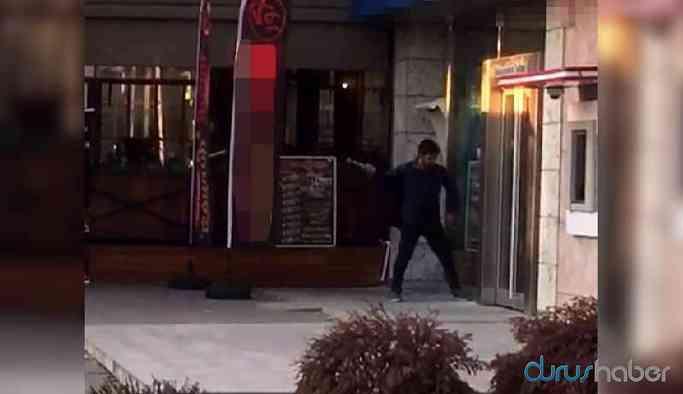 Cezaevine girmek isteyen kişi banka camını kırdı