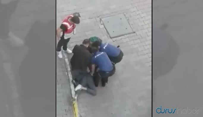 Yine polis şiddeti... Sitenin önüne çıkan genç darp edilip gözaltına alındı