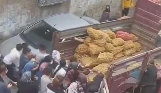 İhtiyaç sahiplerine patates ve soğan dağıtımı böyle yapıldı