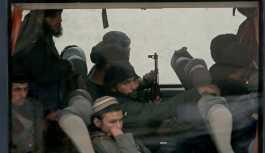Doğu Guta'dan çıkan militanlar Suriye'nin...