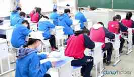 Salgının başladığı Çin'in bazı bölgelerinde eğitim tekrar başladı