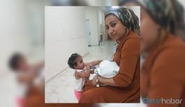 10 günlük bebeği ve 2 yaşındaki kızıyla birlikte tutuklandı